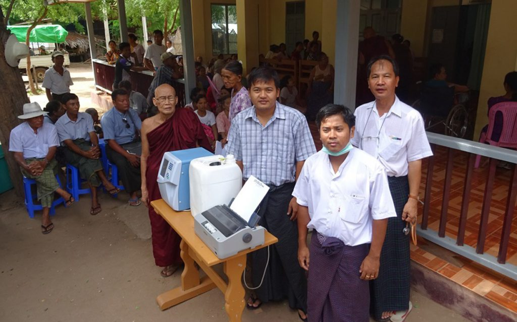 Bagan clinic staff with blood analyzer donated by SFI